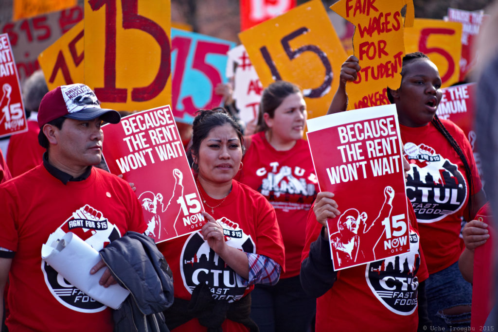 A photo of people in CTUL shirts holding protest signs