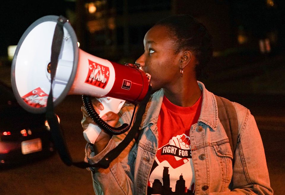 A photo of a young person holding a megaphone.